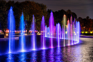 Fotobehang Fontaine Fountain Illuminated at Night in Warsaw, Poland