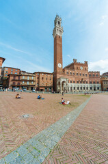 Fototapete - Mangia Tower in Piazza del Campo in historic city Siena, Tuscany, Italy