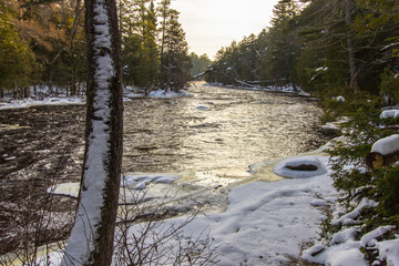 Wall Murals Dark grey Winter River Sunrise Landscape. Sunrise over the Tahquamenon River after a fresh snowfall in the Upper Peninsula of Michigan.