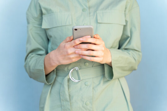 Close-up of woman using cell phone