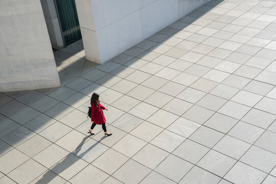 View from above of walking modern businesswoman on a concrete floor
