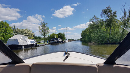 Sailing on a river - view from the boat