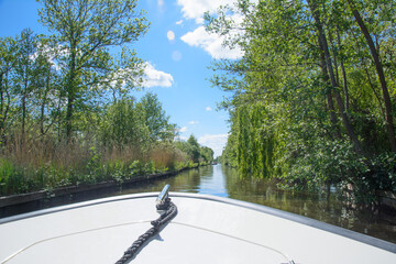 Sailing on a boat on a canal in the Netherlands