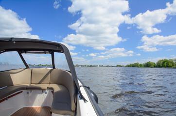 Sailing on a boat on Loosdrecht lake, Netherlands