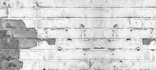 White gray painted light damaged rustic brick wall masonry texture banner panorama, with copy space