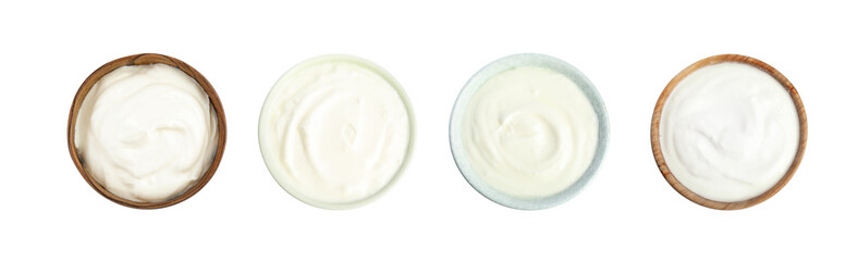 Set of delicious natural yogurt in bowls on white background, top view. Banner design