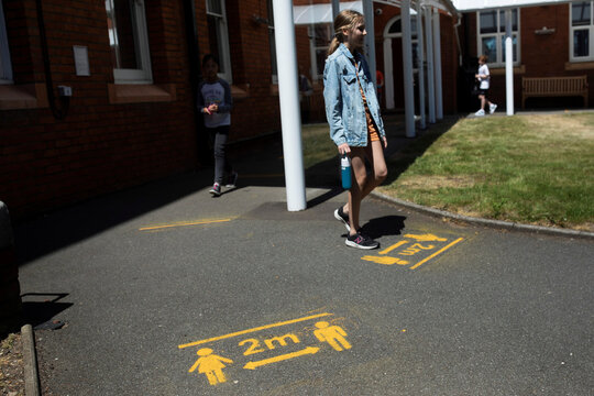 Children queue to enter the lunch hall at St Dunstan's College junior school as some schools re-open following the outbreak of the coronavirus disease (COVID-19) in London