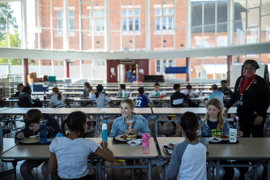 Children eat their lunch at St Dunstan's College junior school as some schools re-open following the outbreak of the coronavirus disease (COVID-19) in London
