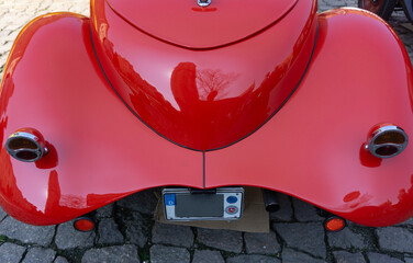 Rear area side of a red classic sports car, the Fiat 514 MM as a roadster in Braunschweig, Germany, April 7., 2019