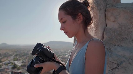 Wall Mural - Female photographer, taking pictures of mountain landscape at sunset in Turkey