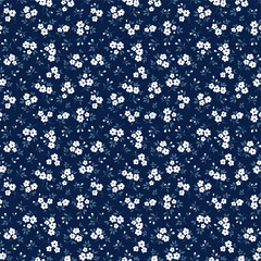 Elegant floral pattern in small white flowers. Liberty style. Floral seamless background for fashion prints. Ditsy print. Seamless vector texture. Spring bouquet. - 354398801