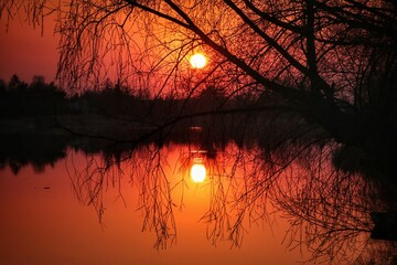 Papiers peints Orange eclat sunset on the lake