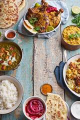 Indian cuisine dinner: tandoori chicken, biryani
