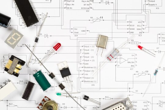 Different electronic parts or components on pcb wiring scheme with resistors, capacitors, diode and ic chips, flat lay top view from above