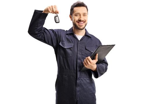 Auto mechanic holding car key