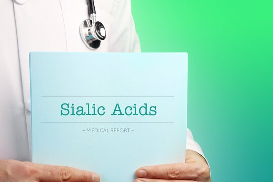 Sialic Acids. Doctor (male) with stethoscope holds medical report in his hands. Cutout. Green turquoise background. Text is on the documents. Healthcare/Medicine