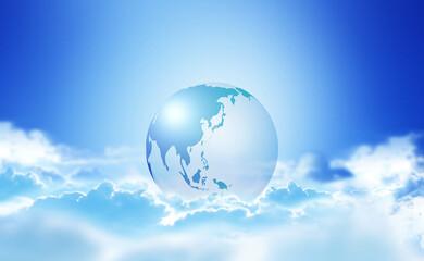 広がる空と雲の上の地球のアイコン