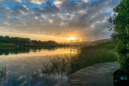 River sunset landscape with beautiful clouds, water reflection
