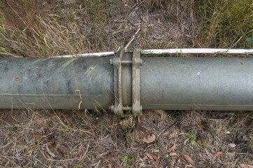 Water pipe with metal flange fittings. Industrial infrastructure