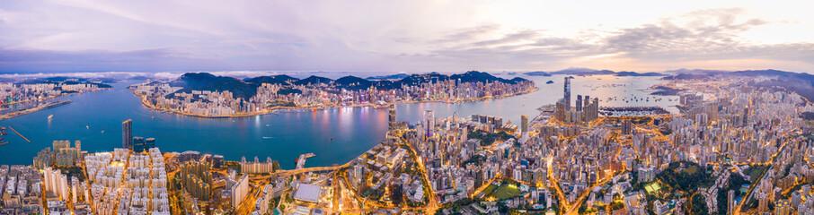 Wall Mural - Epic aerial view of Victoria Harbour, Hong Kong, Twilight metropolis, panorama