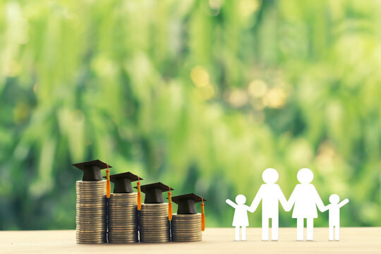 Family members, rows of rising coins with graduation cap or hat on a table. Saving money for kid, child education concept depicts increasing in cost for paying tuition fee when study higher class