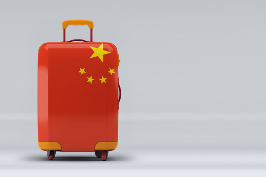 China national flag on a stylish suitcases on color background. Space for text. International travel and tourism concept. 3D rendering.