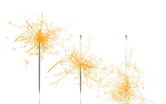 Set of burning sparklers on white background. Party decor