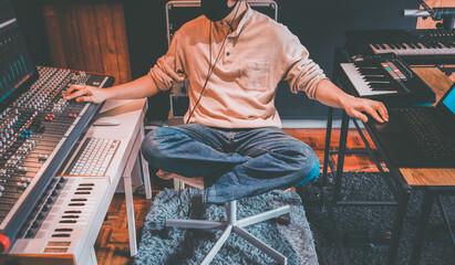 retro portrait of male music producer working in home recording studio