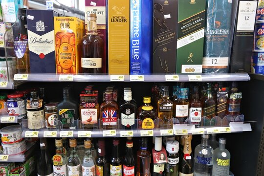 ALISHAN, TAIWAN - DECEMBER 1, 2018: Alcoholic beverage selection at a convenience store in Alishan, Taiwan. Multiple brands of whisky, bourbon and vodka.