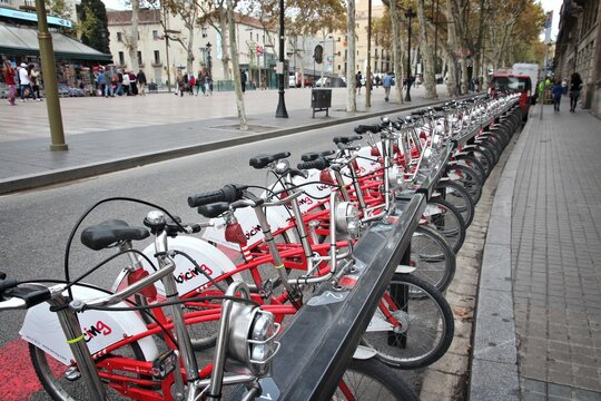 BARCELONA, SPAIN - NOVEMBER 6, 2012: Bicing bikes in Barcelona, Spain. Bicing is one of oldest city bike networks with 400 stations and 6,000 bicycles.
