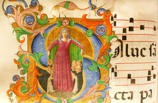 Virgin Mary and Dominican monks on page of paper book, in the library of Museum San Marco, 15th century monastery. Florence, Italy.