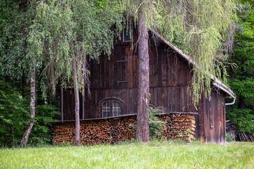 Holzscheune oder Schuppen mit Brennholzvorrat Wall mural