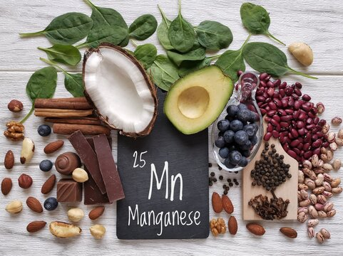 Foods rich in manganese with the chemical symbol Mn for the chemical element manganese. Natural sources of manganese: avocado, cloves, cinnamon, peppercorn, spinach, dark chocolate, beans, blueberry.