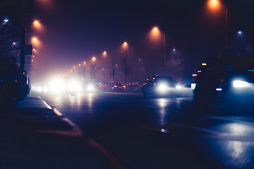 Traffic in the city with car lights and street lighting at night Fotomurales