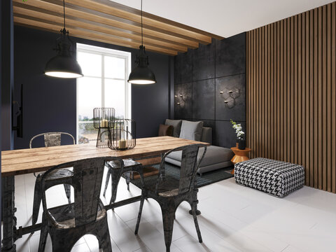 Modern sofa and dining table with iron chairs in the loft interior of a studio apartment. Dark concrete panel and wooden planks on the wall.