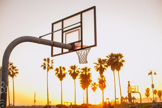 basketball hoop overlooking the sunset on the beach in California