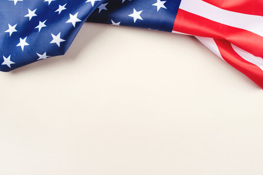 American flag on a gray background. US independence day. Copy space for text.