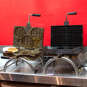 Two waffle irons in the bakery in Brussels. Forms for cooking Brussels and Liege waffles