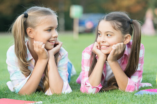 Youre awesome just like me. Happy children relax on green grass. Beauty look of small children. Little children enjoy happy childhood. International childrens day. Having friends is good for children