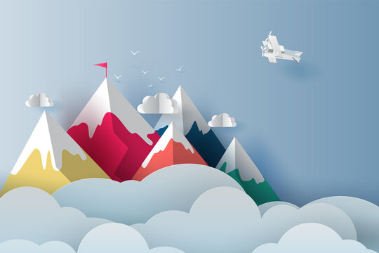Nature Landscape Plane flying over targeted top colorful mountain with red flag on blue sky.Business success and teamwork targeted mountain concept idea. Creative Paper art and digital craft style