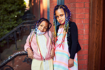Young Mixed Race Girls In Masks On Brownstone Stoop