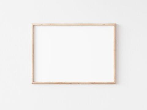 Landscape thin wooden frame on white wall. Horizontal wooden frame. 3d illustration.
