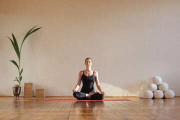 Woman sitting in lotus position meditating