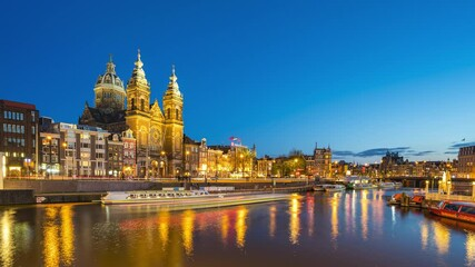 Wall Mural - Amsterdam cityscape with view of canal and church 4K night time lapse