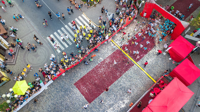Marathon running race, aerial view of start and finish line with many runners from above, road racing, sport competition, fitness and healthy lifestyle concept