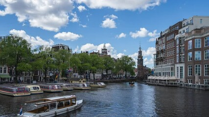 Wall Mural - Time lapse of Amsterdam cityscape with view of canal in Netherlands