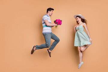 Full size profile photo of attractive lady handsome guy excited married couple travel jump high...