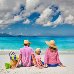 Fototapete - Family with three year old boy on beach. Seychelles, Mahe.