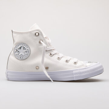 VIENNA, AUSTRIA - AUGUST 28, 2017: Converse Chuck Taylor All Star Brush off Leather Toecap white and silver sneaker on white background.