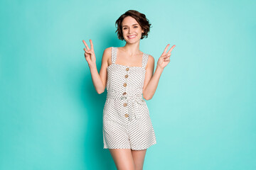 Photo of funny cheerful lady good mood showing v-sign symbols hands say hello friends wear casual...
